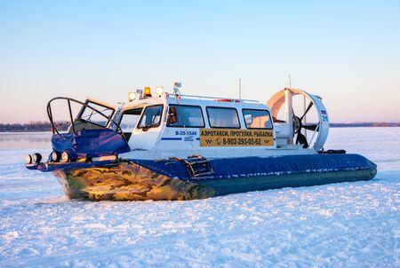 hovercraft: SAMARA, RUSSIA - JANUARY 10, 2016: Hovercraft transporter at the Volga embankment in winter sunny day
