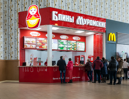 famous industries: SAMARA, RUSSIA - MARCH 8, 2015: Fast food restaurant Pancakes of Murom (Bliny Muromskie) in hypermarket Ambar. The menus are based on traditional Russian cuisine - pancakes, soups, porridge
