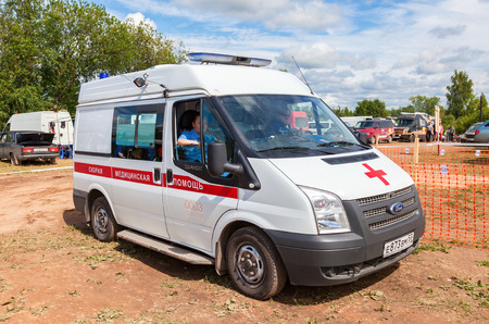 acute care: BOROVICHI, RUSSIA - JULAY 11, 2015: Ambulance car parked up in the rural street. Text on russian: Acute care