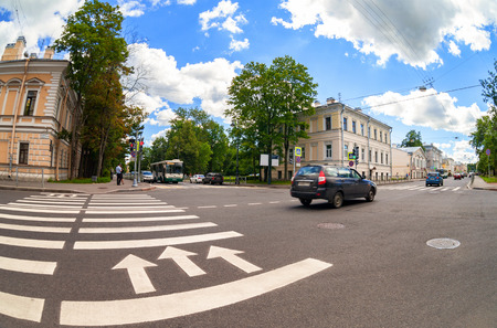 city pushkin: SAINT-PETERSBURG, RUSSIA - AUGUST 4, 2015: Zebra crossing with white marking lines and direction of motion on asphalt at the city street. Pushkin, Russia