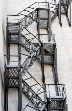 metallic stairs: Metal fire stairs on the facade of building Stock Photo
