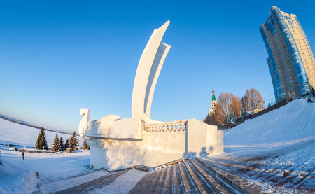 shallop: SAMARA, RUSSIA - JANUARY 10, 2016: Monument Boat at the city embankment. Winter urban landscape in sunny day