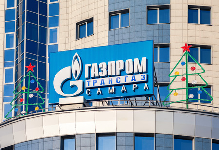 supervisory: SAMARA, RUSSIA - JANUARY 17, 2015: The logo of Gazprom on the facade of the administrative and supervisory office of LLC Gazprom Transgaz Samara
