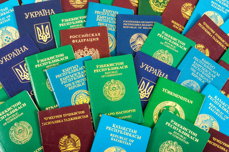 emigration: Different foreign passports as colorful background