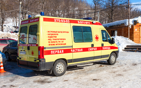 SAMARA, RUSSIA - FEBRUARY 14, 2016: Ambulance car parked up in sunny day. Text in russian: The first private ambulance