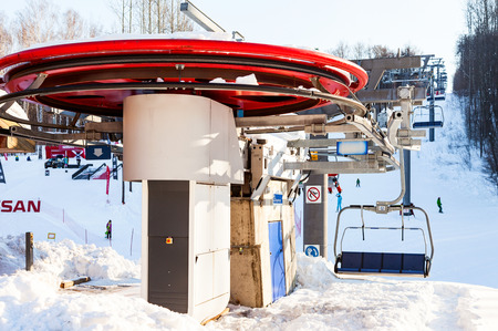 chairlift: SAMARA, RUSSIA - FEBRUARY 14, 2016: Chairlift in Krasnaya Glinka mountain ski resort in winter sunny day in Samara, Russia