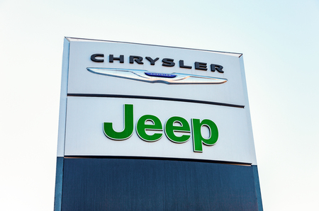 automobile dealership: SAMARA, RUSSIA - FEBRUARY 13, 2016: Chrysler, Jeep automobile dealership sign. All are part of the Chrysler Motor Company an American automobile manufacturer