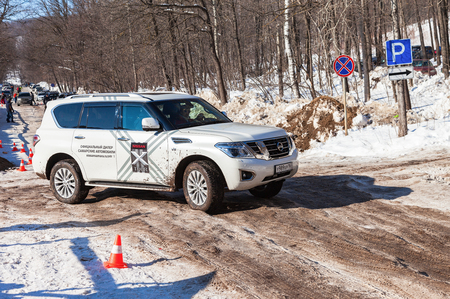 automaker: SAMARA, RUSSIA - FEBRUARY 14, 2016: Vehicle Nissan Patrol moving  in sunny day on the rural road. Nissan is a Japanese multinational automaker