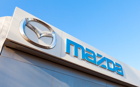 SAMARA, RUSSIA - FEBRUARY 20, 2016: Official dealership sign of Mazda. Mazda Motor Corporation is a Japanese automaker