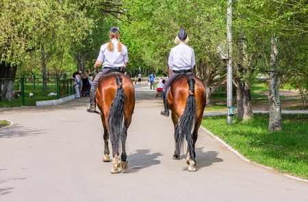 arresting: SAMARA, RUSSIA - MAY 9, 2015: Female mounted police on horse back in the city Park