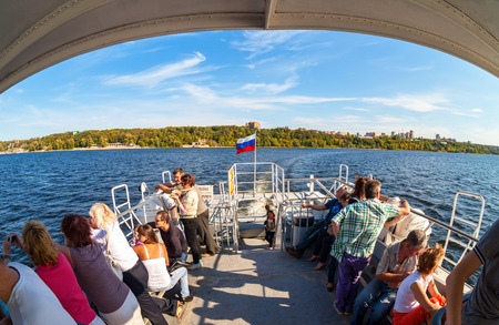 excursion: SAMARA, RUSSIA - SEPTEMBER 15, 2015: Tourists at the excursion boat traveling by the Volga river in a sunny summer day