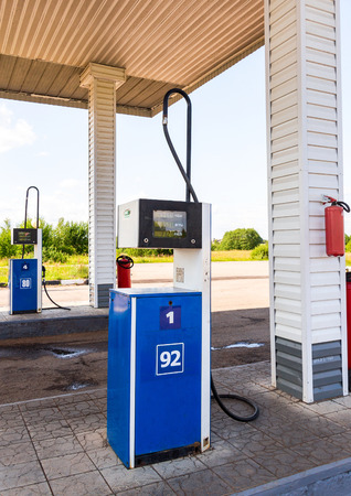 fueling pump: BOROVICHI, RUSSIA - JULY 18, 2015: Filling the column with different fuels at the gas station Surgutneftegas. Surgutneftegas is one of the russian oil companies