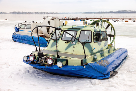 hovercraft: Hovercraft transporters at the Volga embankment in winter day