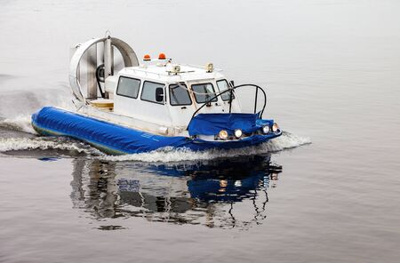 hovercraft: Hovercraft transporter at the Volga river in winter day