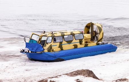 hovercraft: SAMARA, RUSSIA - MARCH 6, 2016: Hovercraft on the ice of the frozen Volga River in Samara Editorial