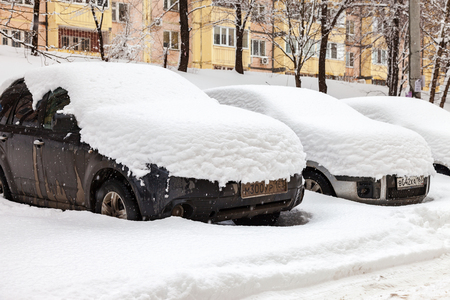 inclement weather: SAMARA, RUSSIA - FEBRUARY 28, 2016: Vehicles covered with snow in the winter blizzard in the parking lot Editorial