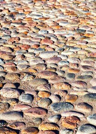paved: Old paved roadway as background close up