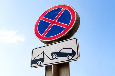 evacuation: Traffic sign prohibiting parking. Evacuation on tow truck