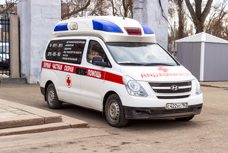 SAMARA, RUSSIA - MARCH 13, 2016: Ambulance car parked up in the street. Text in russian: The first private ambulance