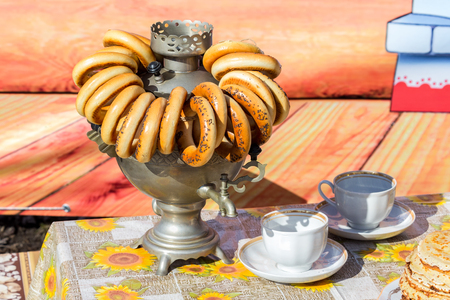 cake plate: Traditional Russian tea from Samovar with bagels and pancakes