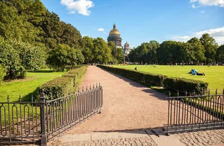 metal gate: Metal gate at the green meadow near the St. Isaac Cathedral in St. Petersburg, Russia Stock Photo