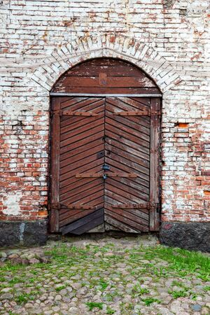 dilapidation: Old wooden gate at the medieval castle in Vyborg, Russia