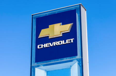 chevrolet: SAMARA, RUSSIA - MARCH 20, 2016: Chevrolet dealership sign against blue sky. Chevrolet is a American automobile manufacturer