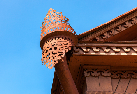 rainwater: The old rainwater downpipe on wooden house