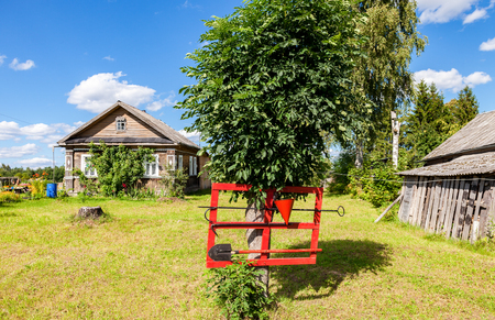 extinguishing: Firefighter shield with fire extinguishing tools in Russian village