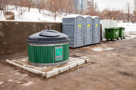 environmental sanitation: SAMARA, RUSSIA - MARCH 6, 2016: Public toilets and garbage cans on city street