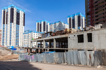 concrete commercial block: SAMARA, RUSSIA - APRIL 10, 2016: New tall apartment buildings under construction in sunny day