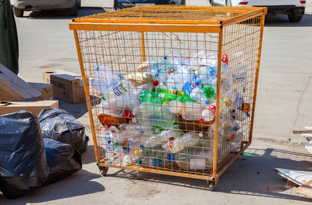 crushed cans: SAMARA, RUSSIA - April 16, 2016: The container for collecting plastic bottles of various drinks for recycling