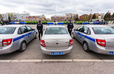 police unit: SAMARA, RUSSIA - APRIL 20, 2016: Russian police patrol vehicles parked on the Kuibyshev square in spring day