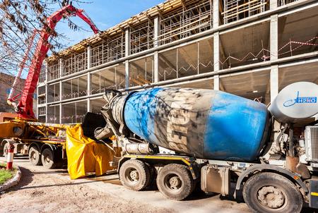 concrete pump: SAMARA, RUSSIA - APRIL 26, 2016: Automobile concrete pumping machine able to pump concrete in large quantities at the construction building