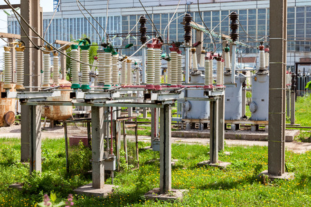 isolator switch: Part of high-voltage substation with switches in summer sunny day
