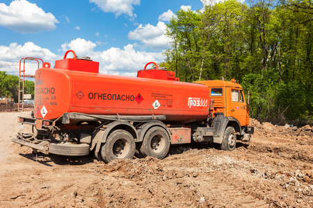 outside machines: SAMARA, RUSSIA - MAY 7, 2016: Gasoline tanker truck at the construction site under construction of new road Editorial