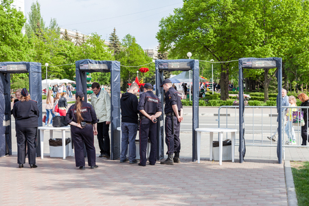 constabulary: SAMARA, RUSSIA - MAY 8, 2016: Fence with police frames metal detectors at the central square in summer day