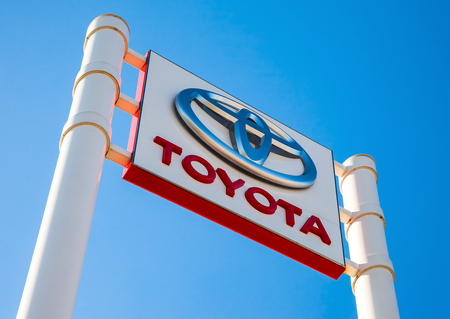 SAMARA, RUSSIA - MAY 14, 2016: Official dealership sign of Toyota against the blue sky background. Toyota Motor Corporation is a Japanese automotive manufacturer Editorial