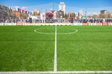 central square: SAMARA, RUSSIA - APRIL 24, 2016: White lines marking on green grass on the soccer or football field. Open sport festival on the central square in Samara, Russia