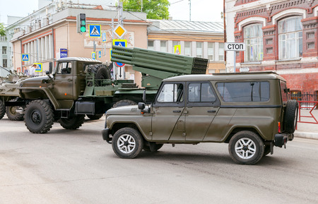 hussar: SAMARA, RUSSIA - MAY 9, 2016: Special armored vehicle UAZ-3152 Hussar and BM-21 Grad Multiple Rocket Launcher on Ural-375D chassis at the street during the parade on Victory Day Editorial