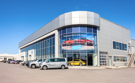 automaker: SAMARA, RUSSIA - MAY 14, 2016: New cars parked up near the office building of official dealer Volkswagen. Volkswagen Group is the biggest German automaker