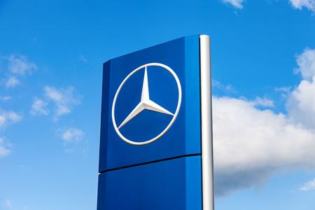 benz: SAMARA, RUSSIA - MAY 22, 2016: Official dealership sign of Mercedes-Benz over blue sky. Mercedes-Benz is a German automotive manufacturer