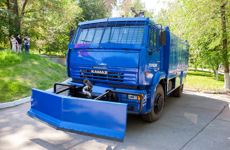 demonstrations: SAMARA, RUSSIA - MAY 28, 2016: Russian police heavy truck to disperse demonstrations parked at the city park in summer day