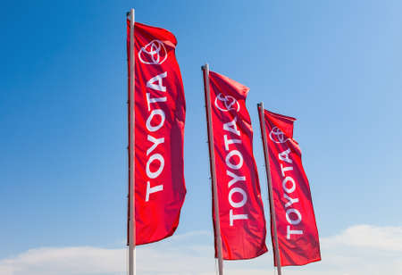 branded: SAMARA, RUSSIA - MAY 29, 2016: Official dealership flags of Toyota against the blue sky background. Toyota Motor Corporation is a Japanese automotive manufacturer Editorial