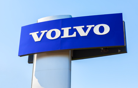 automaker: SAMARA, RUSSIA - MAY 29, 2016: Volvo dealership sign against the blue sky. Volvo is a Swedish multinational automaker company headquartered in Gothenburg, Sweden