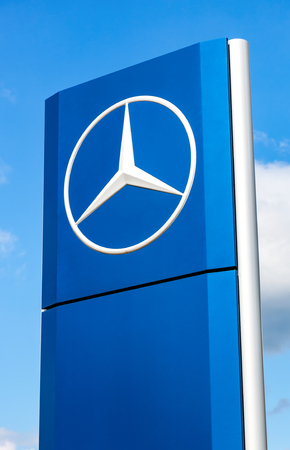 manufacturer: SAMARA, RUSSIA - MAY 22, 2016: Official dealership sign of Mercedes-Benz over blue sky. Mercedes-Benz is a German automotive manufacturer