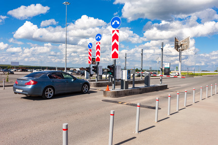 SAMARA, RUSSIA - MAY 22, 2016: Checkpoint by the car parking in the terminal Samara Kurumoch Airport in summer sunny day