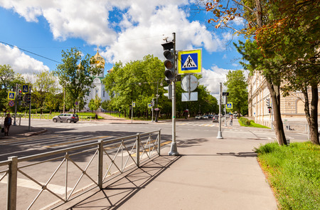city pushkin: SAINT-PETERSBURG, RUSSIA - AUGUST 4, 2015: Pedestrian crossing with white marking lines on asphalt and Orthodox Catherines Cathedral at the city street. Pushkin, Russia