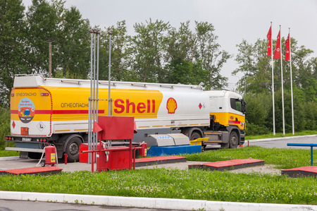 LENINGRAD REGION, RUSSIA - JULY 31, 2016: Shell Oil Truck at the gas station Shell. Royal Dutch Shell or Shell is an Anglo-Dutch multinational oil and gas company