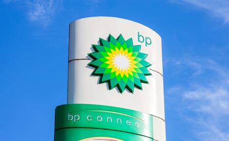bp: NOVGOROD REGION, RUSSIA - JULY 31, 2016: BP - British Petroleum petrol station logo against blue sky. British Petroleum is a British multinational oil and gas company